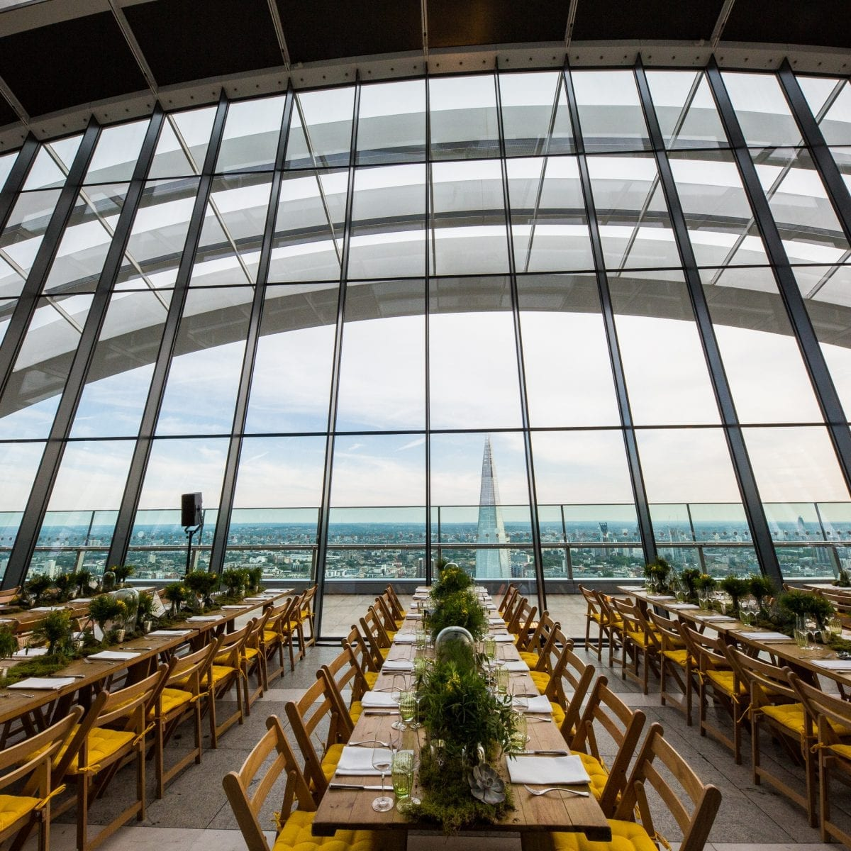 sky garden wooden seating area with shard background